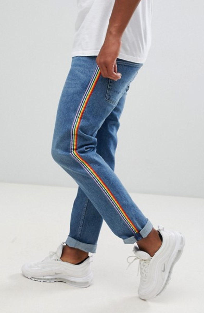 ASOS DESIGN slim jeans in mid wash blue with rainbow stripe