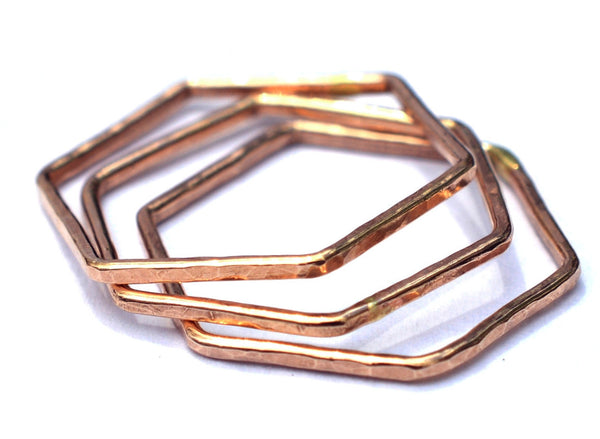rose gold hexagon stacking rings by aquarian thoughts jewelry