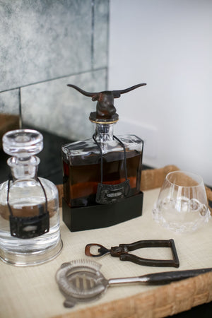 Longhorn Decanter with Clear Glass and Iron Base Styled in Home