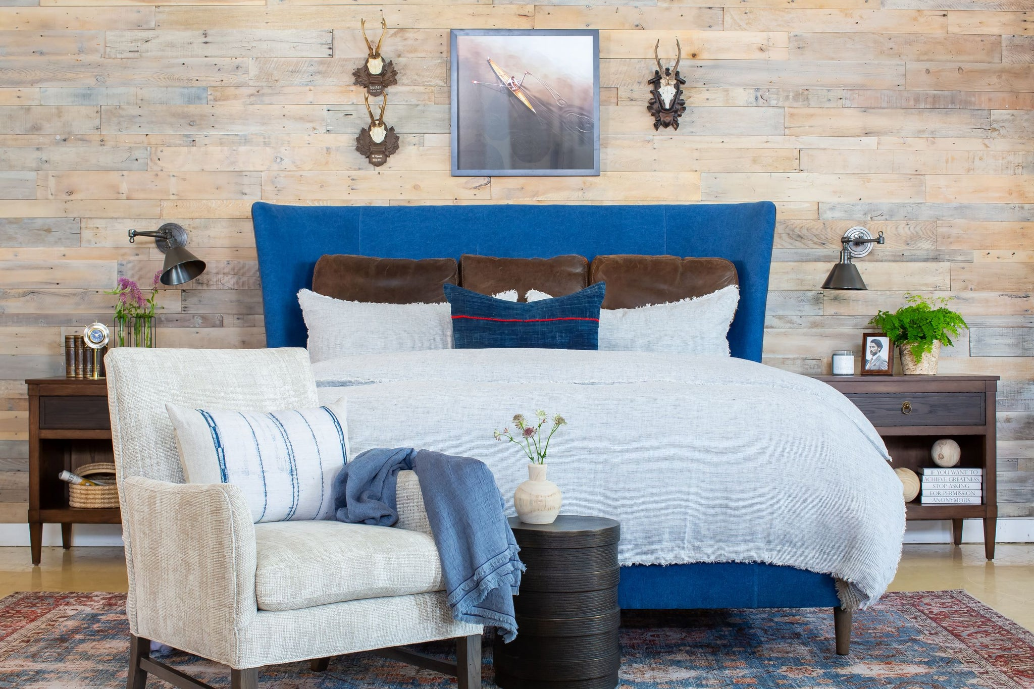 Franklin Upholstered Bed in Blue Fabric with Leather Welt Styled in Bedroom