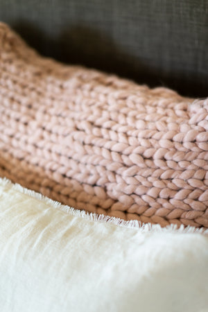 Close Up of Pink Chunky Knit Super King Sham on Bed