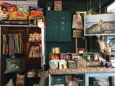 photograph of interior of Wheniwasfour waterloo shop decorated with local-inspired items and novelty items