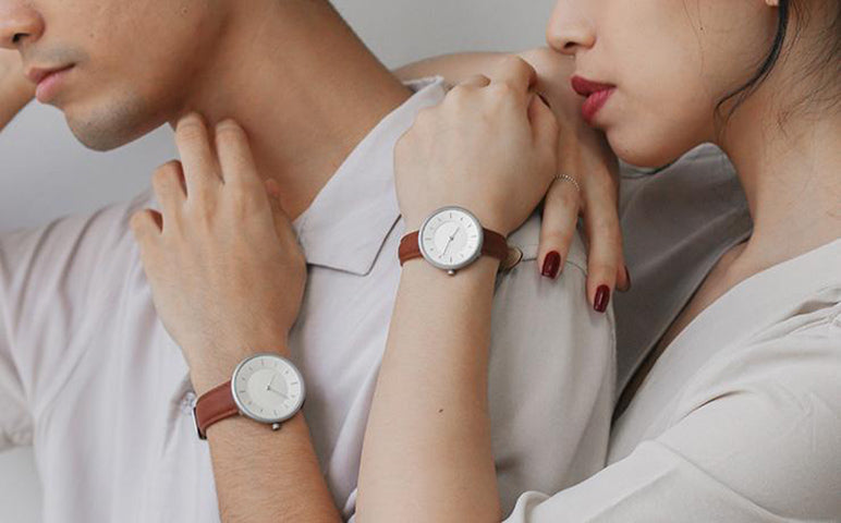image of a couple wearing a matching watch from plain supplies