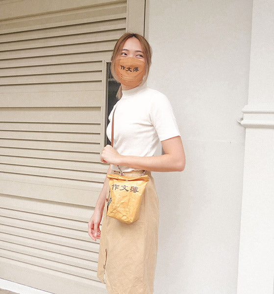 girl carrying wheniwasfour chinese compo kraft paper sling bag with matching mask