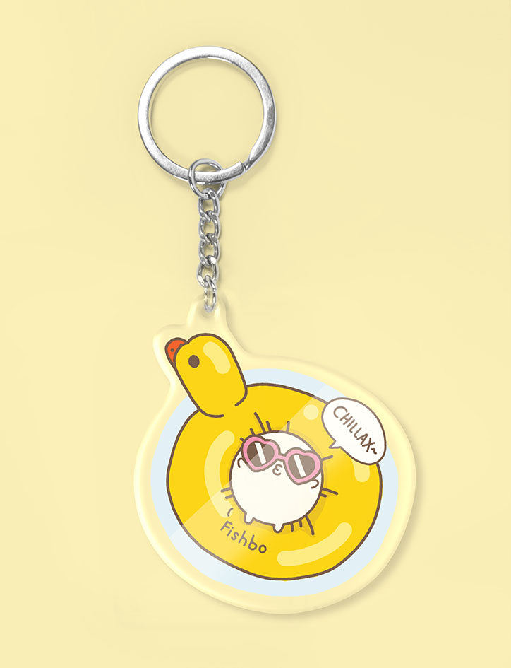 Cute fishball character relaxing in duck float keychain