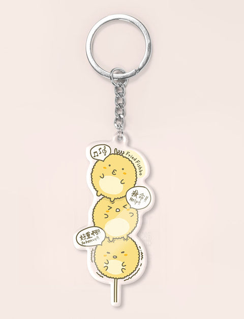 Three cute fried fishball characters on a stick as a keychain