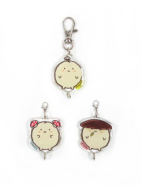 Three cute mushroom fishball characters with different mushroom hairstyles as keychains