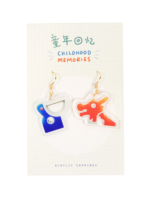 Nostalgic and quirky old school dragon playground dangling earrings