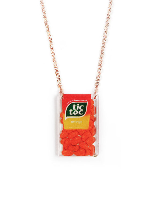 Cute and quirky necklace with orange rectangular pendant shaped like a tic tac sweet - inspired by nostalgia Mama Shop products