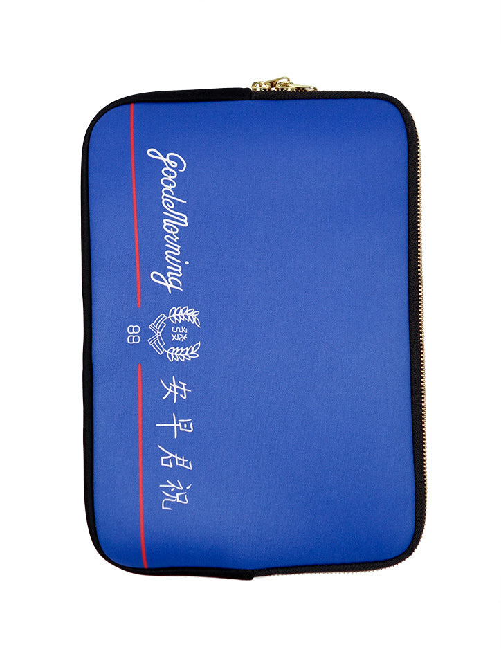 "Blue and white laptop sleeve with iconic and nostalgic ""Good Morning Towel"" design"
