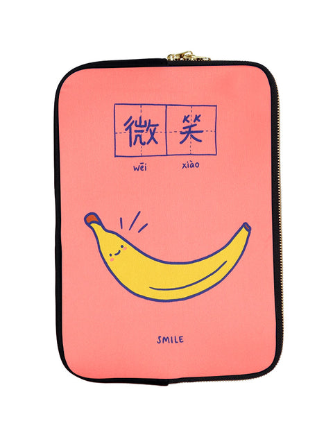 Peach and blue motivational laptop sleeves with a banana saying smile