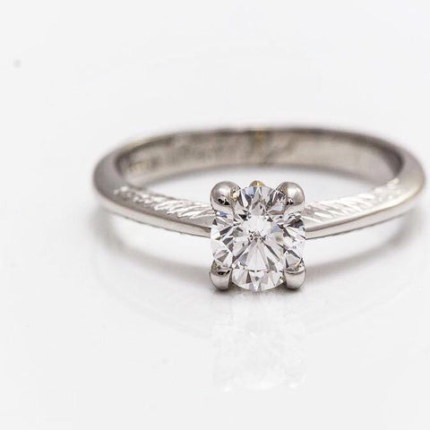 Engraved diamond platinum engagement ring