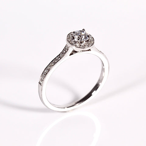 diamond halo ring with diamond set shoulders