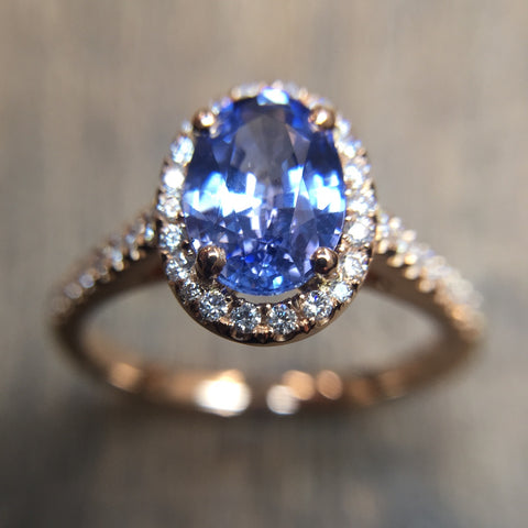 rose gold sapphire halo ring by Phillip Jennings