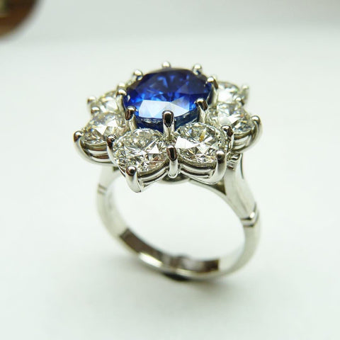 sapphire and diamond cluster ring. handmade in 18ct white gold