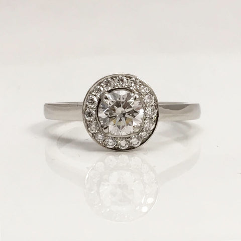 Round diamond halo ring handmade in platinum
