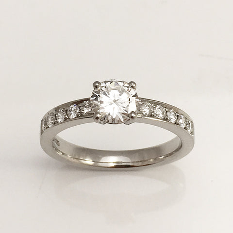 contemporary diamond engagement ring with pave band