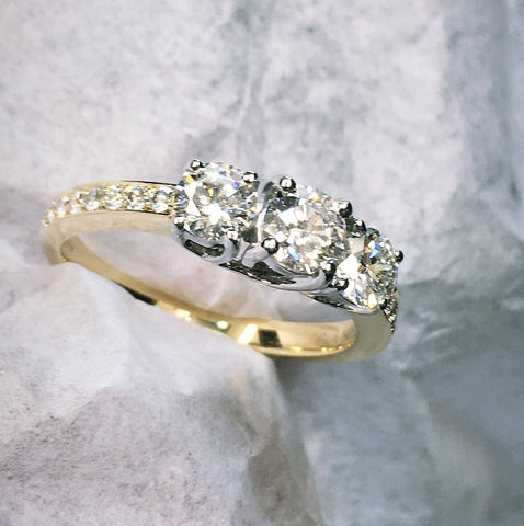 diamond 3 stone engagement ring. platinum and 18ct yellow gold