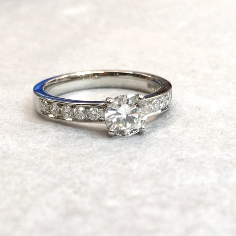diamond platinum engagement ring with diamonds in the band