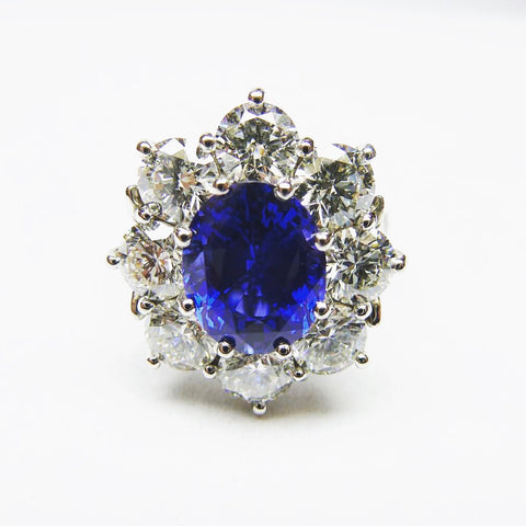 princess Diana sapphire cluster engagement ring