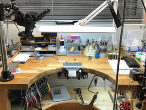 Jewellers workbench with hand tools and microscope in a jewellery workshop