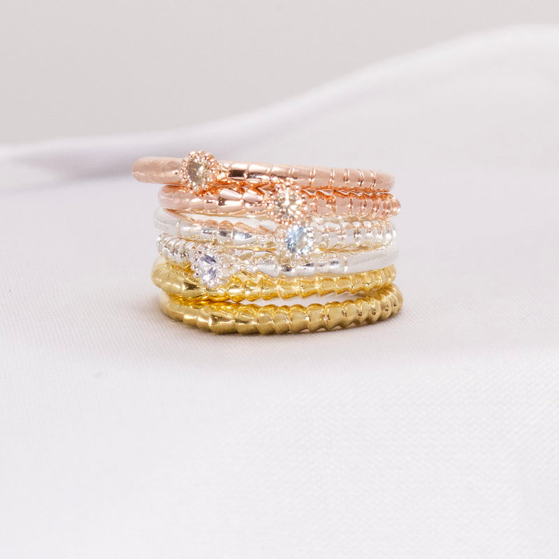 Rose gold, silver and yellow gold rings with champagne diamonds and white sapphires.