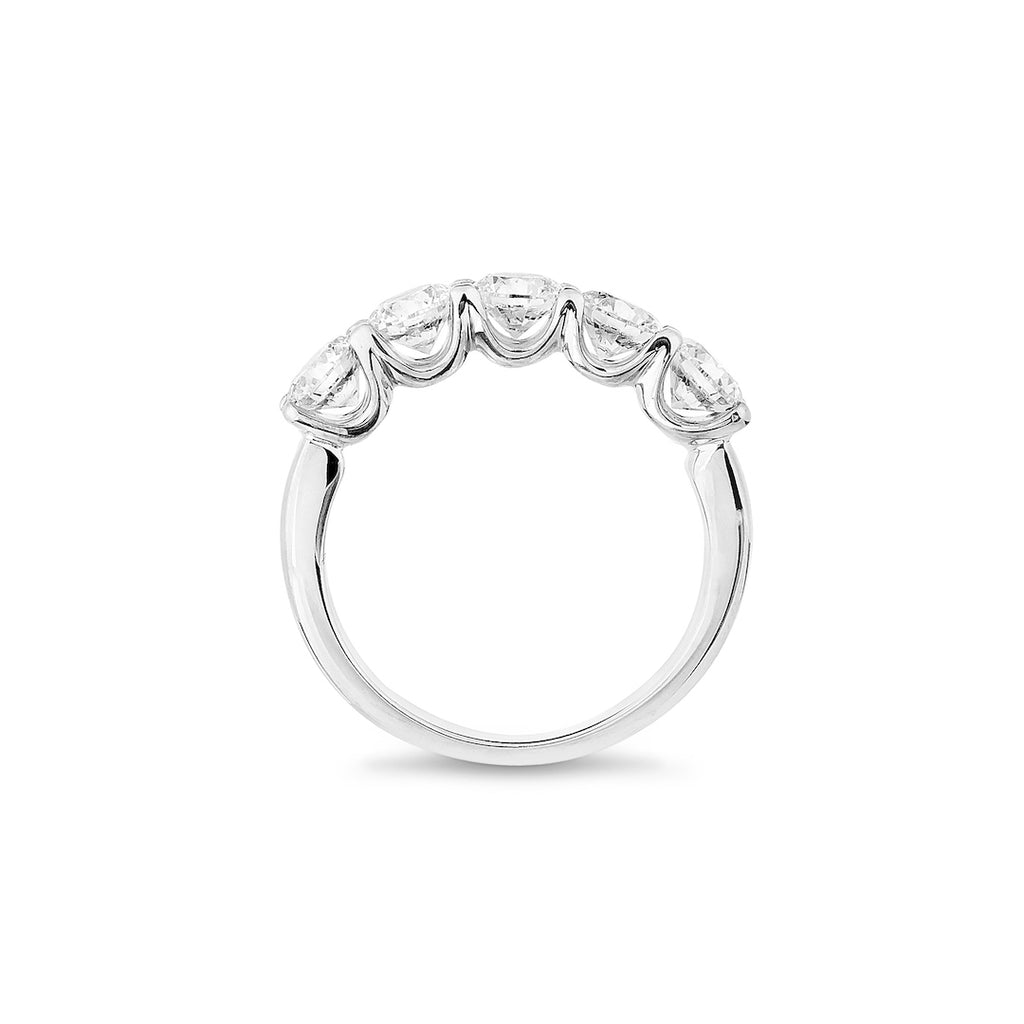 5 x brilliant cut diamond handmade eternity platinum ring stands up on a white background