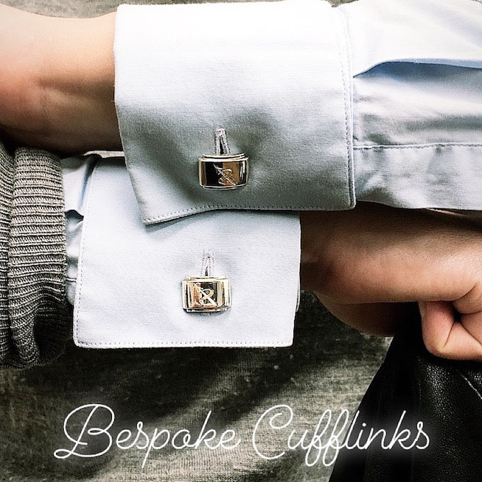 Sterling silver unisex designer cufflinks with bespoke engraving worn in a blue business shirt cuffs
