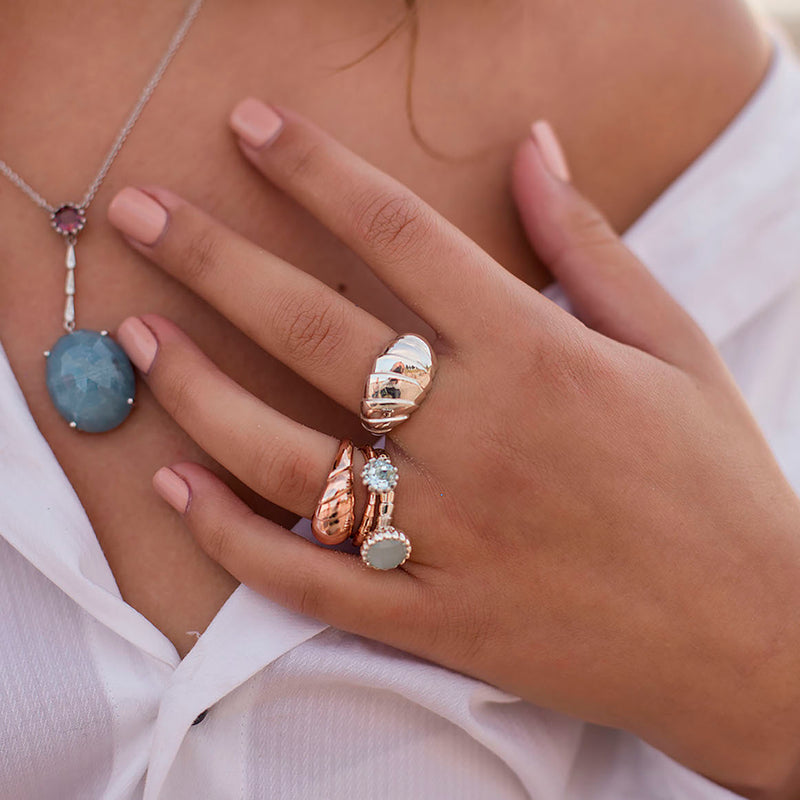 Designer jewellery in gold worn by girl with aquamarine and tourmaline gems
