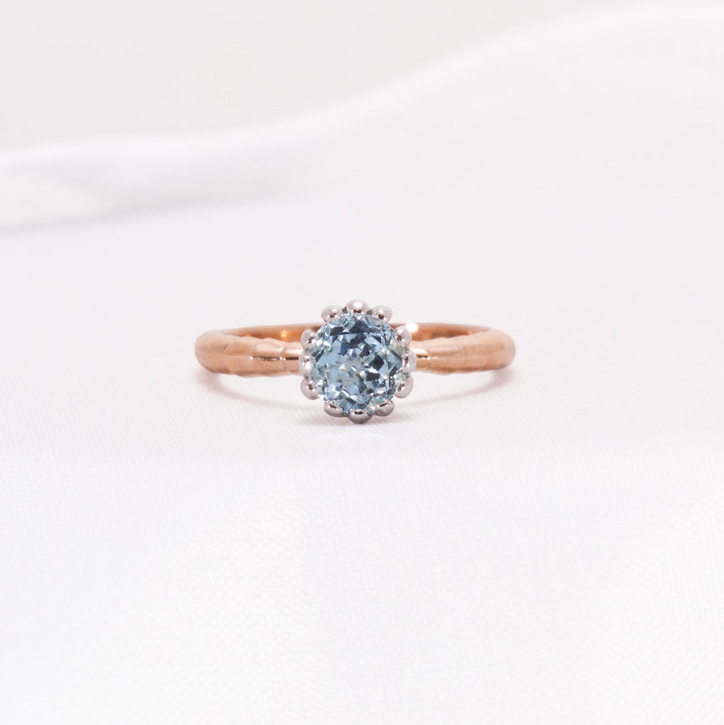 Aquamarine dress ring with rose gold band and white gold setting