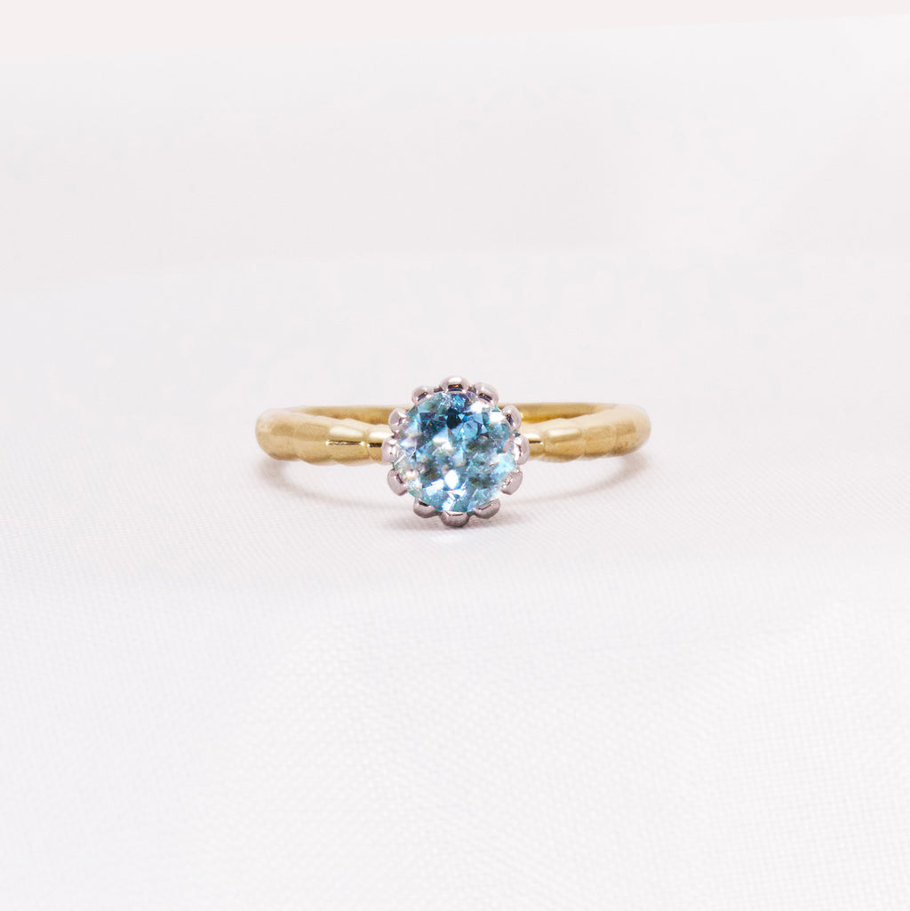 Aqua Gemstone dress ring in yellow gold with white flower setting