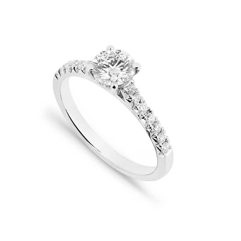 0.90ct brilliant cut diamond platinum engagement ring with diamond set shoulders on a white background. Top view