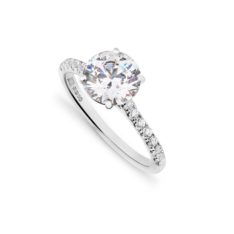2ct bespoke diamond platinum engagement ring with micro diamond shoulders on a white background