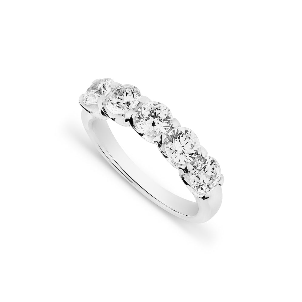 5 stone handmade diamond wedding eternity ring on a white background viewed from above