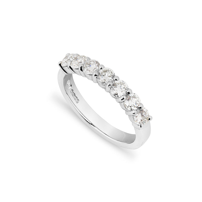 Handmade Bespoke Brilliant cut luxury wedding ring with seven diamonds  on a white background