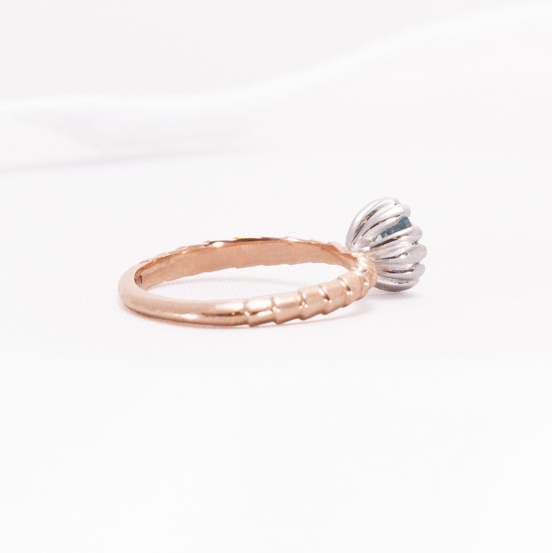 Rose and White gold cocktail dress ring on a white background.