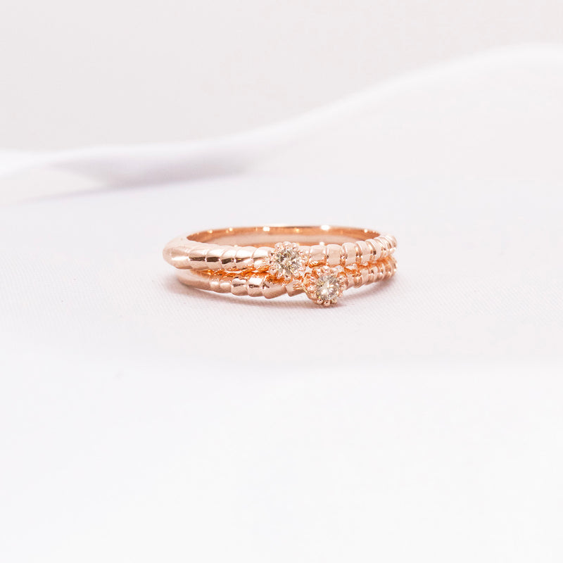 Rose gold rings with champagne diamonds.