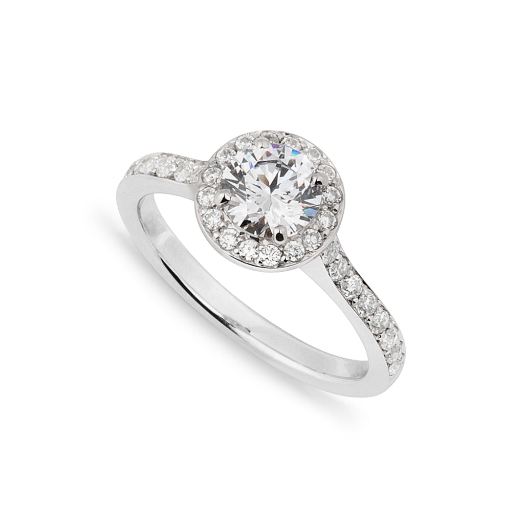 Round Diamond platinum Halo style engagement ring on a white background viewed from above