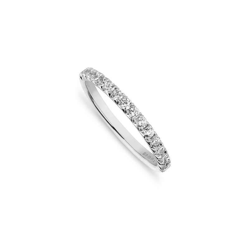 Fine Diamond set platinum wedding band on a white background