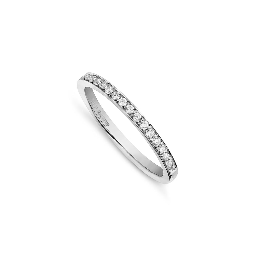 Pave set diamond band handmade by a master jeweller on a white background