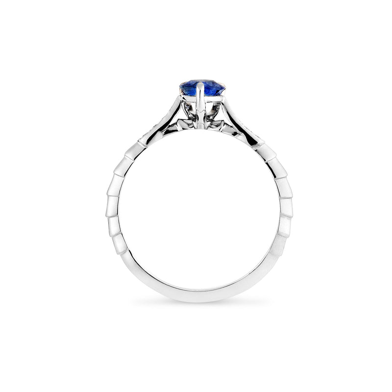 Bespoke jewellery designers blue sapphire and diamond platinum engagement ring. Side View
