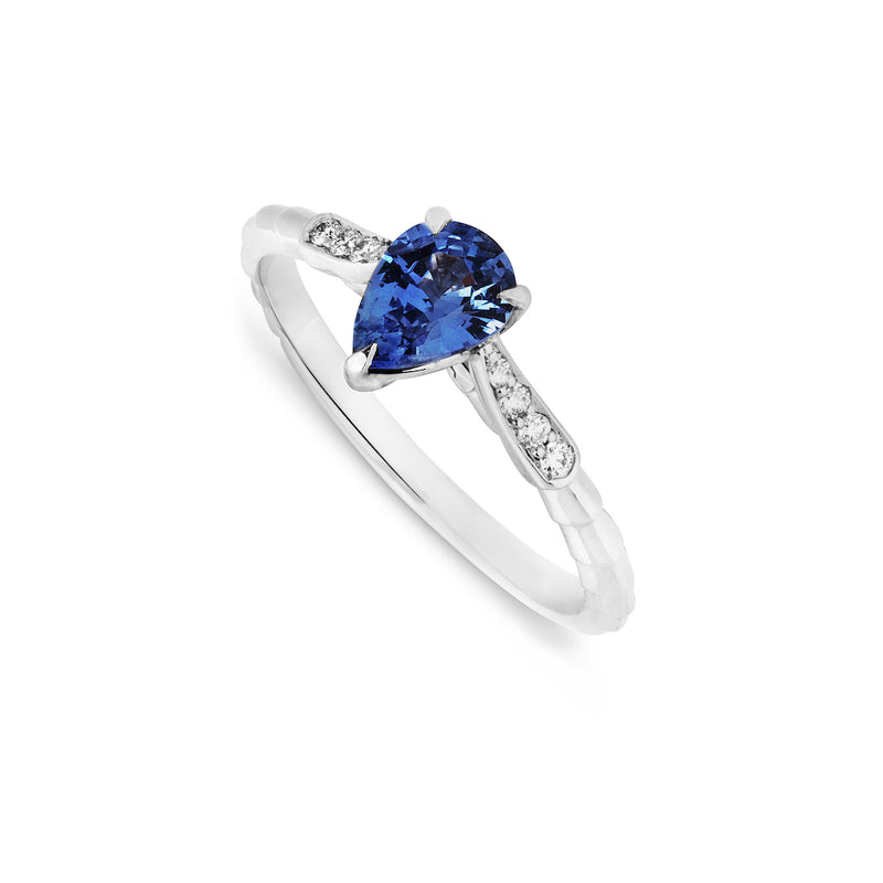 Pear shaped blue sapphire and diamond handmade platinum engagement ring. Top View