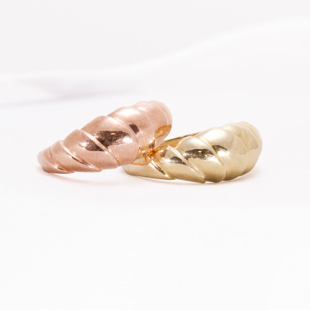 Rose and yellow designer Wainui wave rings stacked up