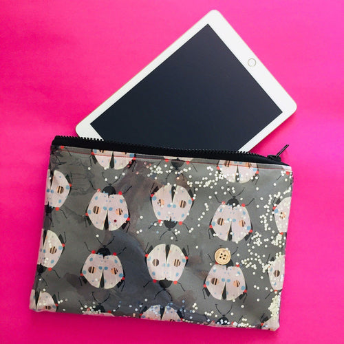 Pink and grey beetle clutch bag