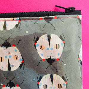 PVC lined beetle pouch with black chunky zip