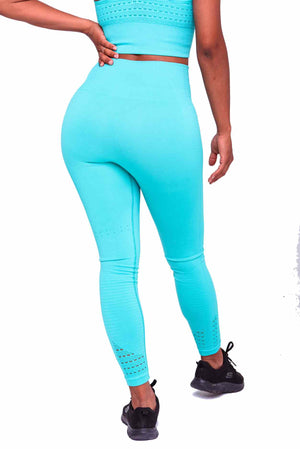 Booty poppin wearing Performance Seamless Booty Leggings in Cyan | ThiqActive
