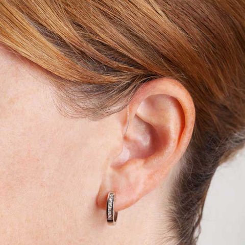 Canto Bluetooth Hearing Aid in woman's ear