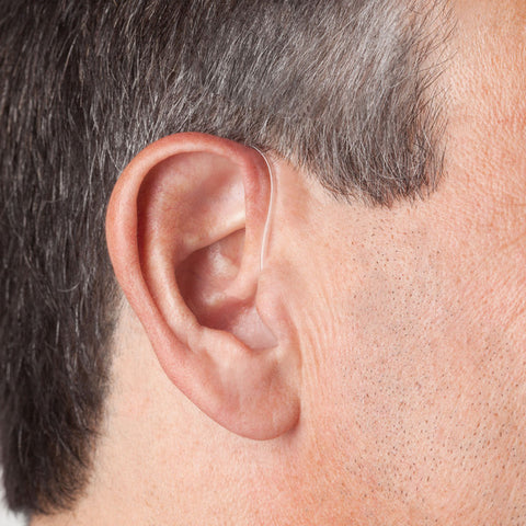 Dia Behind the Ear Hearing Aid in man's ear