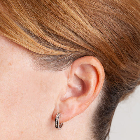 Dia Behind the Ear Hearing Aid in woman's ear