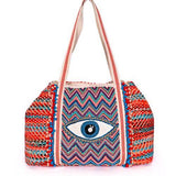 et off for a day in the sun with this beautiful weaved bag.  The Beaded Eye and the fun Tassel details make it a Eye Catcher.....